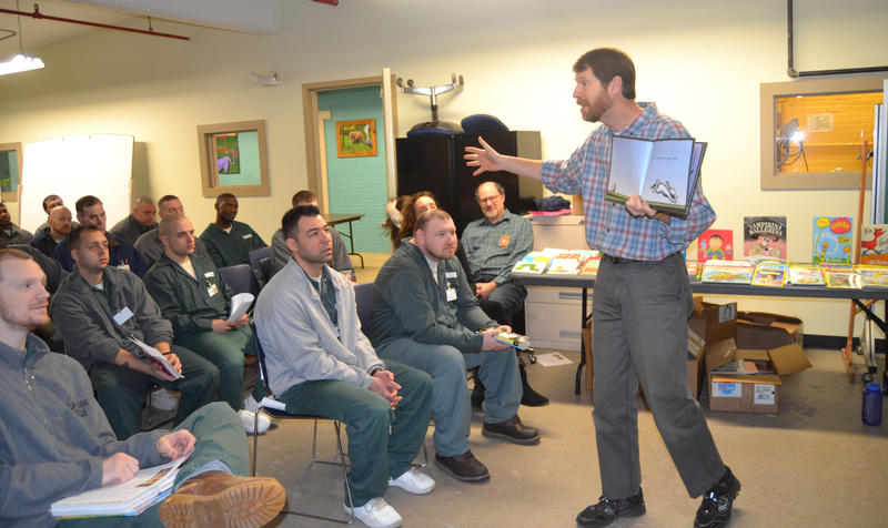 "Duncan McDougall, Executive Director of the Children's Literacy Foundation, reads ""My Friend Rabbit"" to a room full of inmates at the N.H. State Prison in Concord."