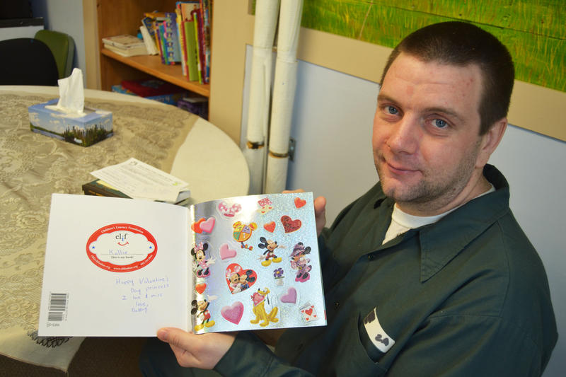 "Jason Eddy, 35, has sent home about a dozen books to his two kids including ""Minnie's Valentine"" for his youngest, Kallie."