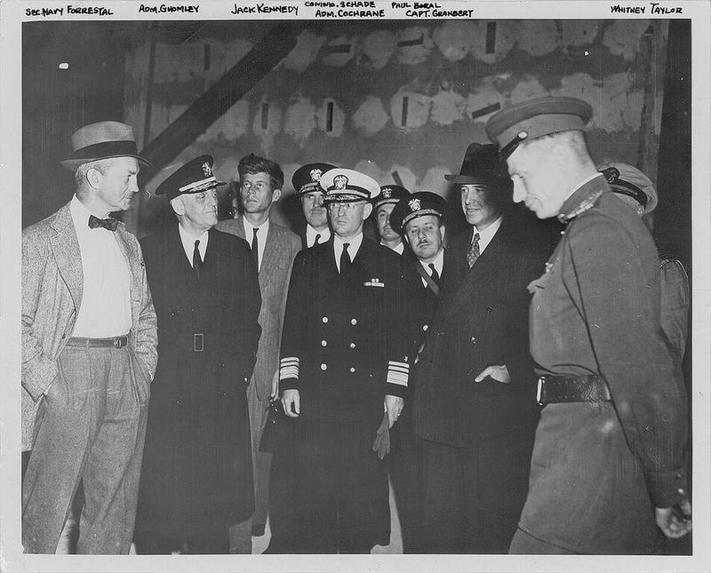 Kennedy, seen third from left, inside the bunker of Adolph Hitler.