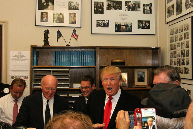 Secretary of State Bill Gardner greets then-candidate Donald Trump during his filing for the 2016 New Hampshire presidential primary.