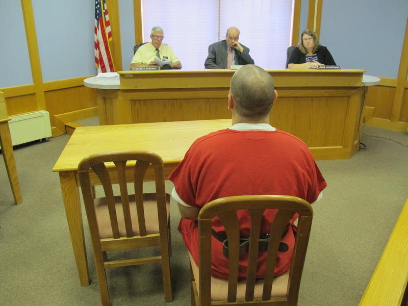 Inmates sit just a few feet from the bench at NH's Adult Parole Board hearings.