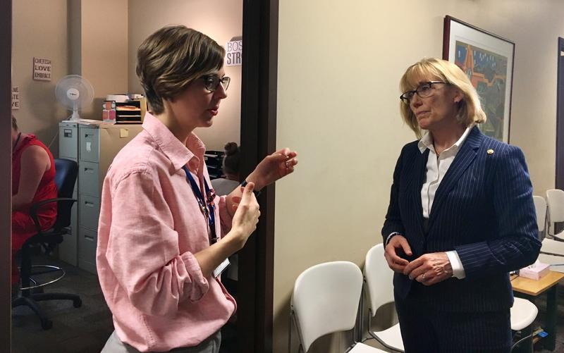 Serenity Place CEO Stephanie Bergeron speaks with Sen. Maggie Hassan during a tour of the treatment center's offices in the old Manchester police station on Monday.