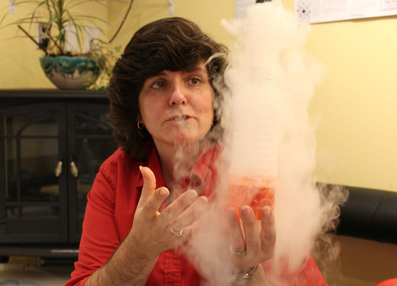 Rita McCabe, one of the owners of Sub Zero Ice Cream & Yogurt in Nashua, N.H., demonstrates what happens when you mix liquid nitrogen and water.