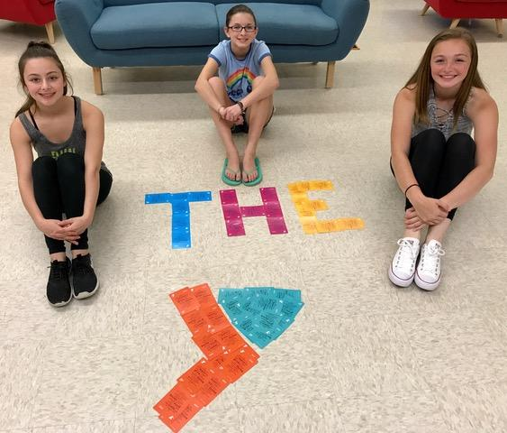 Hudson Middle School students in the photo, from L to R: Olivia Gentile, Mallory Busnach and Maddy Secchiaroli.