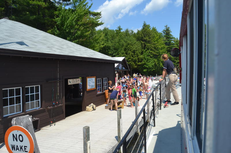 The boat's next stop is Three Mile Island where they are greeted with campers looking to get some ice cream.