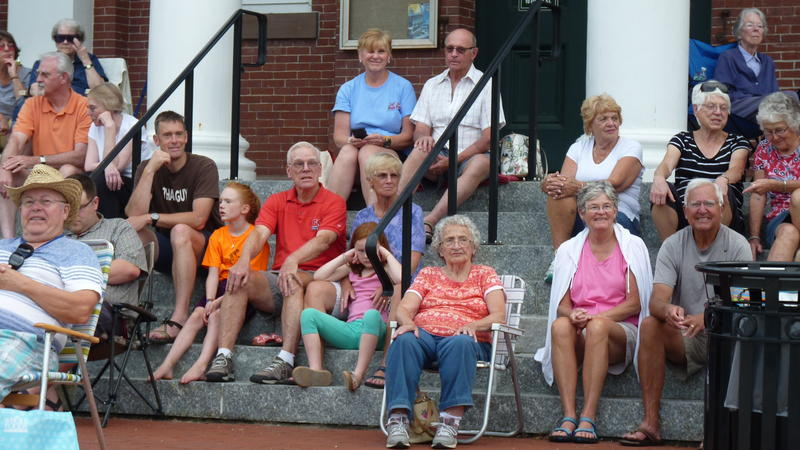 In the old days, the audience used to sit in their cars and honk their horns to show appreciation for the band. Today, people gather in lawnchairs and on the Town Hall steps.