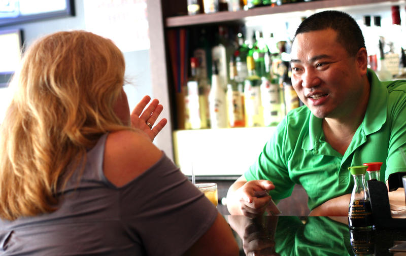 Beth Cacciotti (left) is a regular at Sushi Time in Plaistow, N.H., where she met bartender Jin Lin.