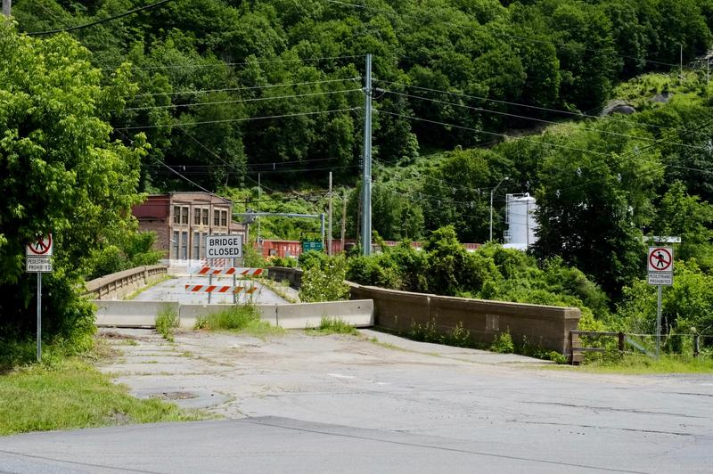 New Hampshire transportation officials closed the Vilas Bridge in 2009 citing safety concerns. Now, almost a decade later, temporary barriers and detour signs remain.