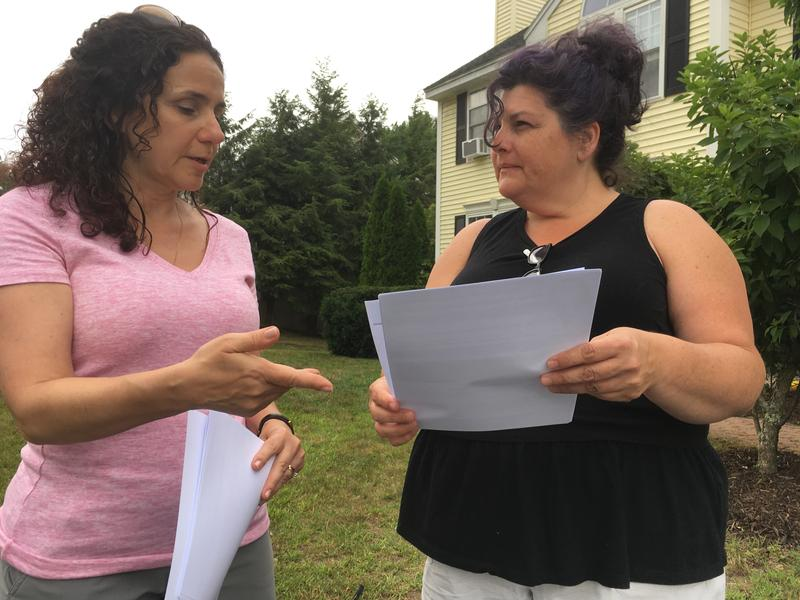 Carol DiPirro talks with neighbor, Andrea Inamorati, about a health survey following water contamination in Merrimack, NH