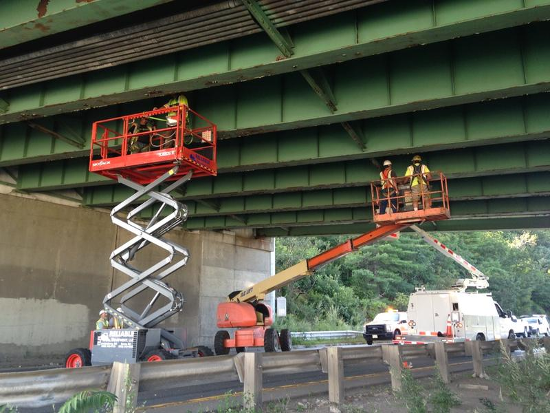Workers repairing the bridge after a piece of concrete fell onto I-93 Southbound in Derry.