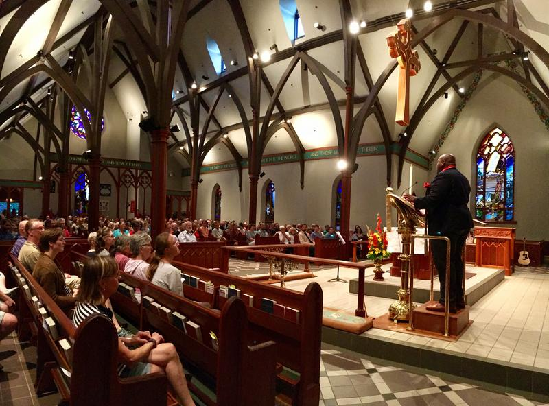"""""""Being a person of faith means that some time or another, we have to be made comfortably uncomfortable by taking risks,"""" Pastor Eric Jackson, of Brookside Congregational Church in Manchester, told the crowd gathered at St. Paul's Episcopal Church Sunday."""