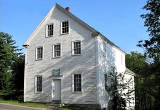 The Grange Hall building was built in 1826 in the town's center as a chapel. (Current Photo)