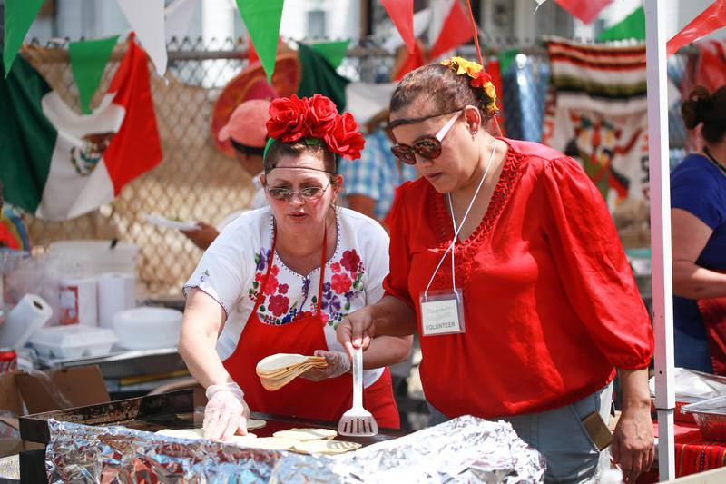 Eva Molina (left) works the grill