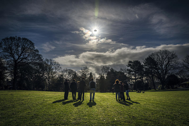 People watching a solar eclipse in Ireland in 2015.
