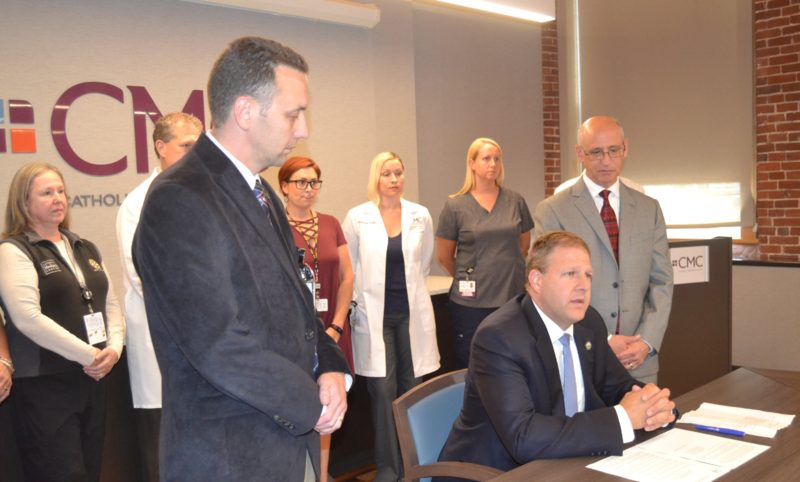 Gov. Chris Sununu signs Executive Order Monday evening to expedite licensing for physicans at Manchester VA to work at state hospitals.