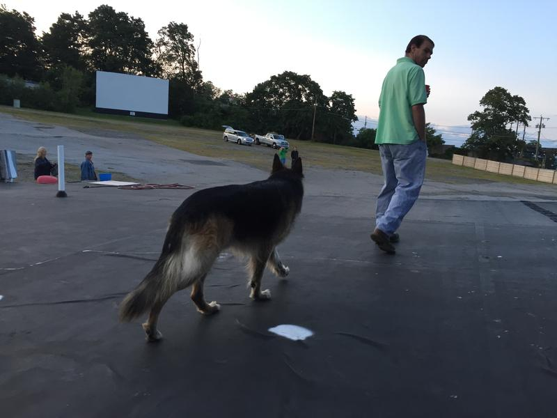 Kevin Baldi, longtime projectionist at the Weirs, with his dog Mogul.