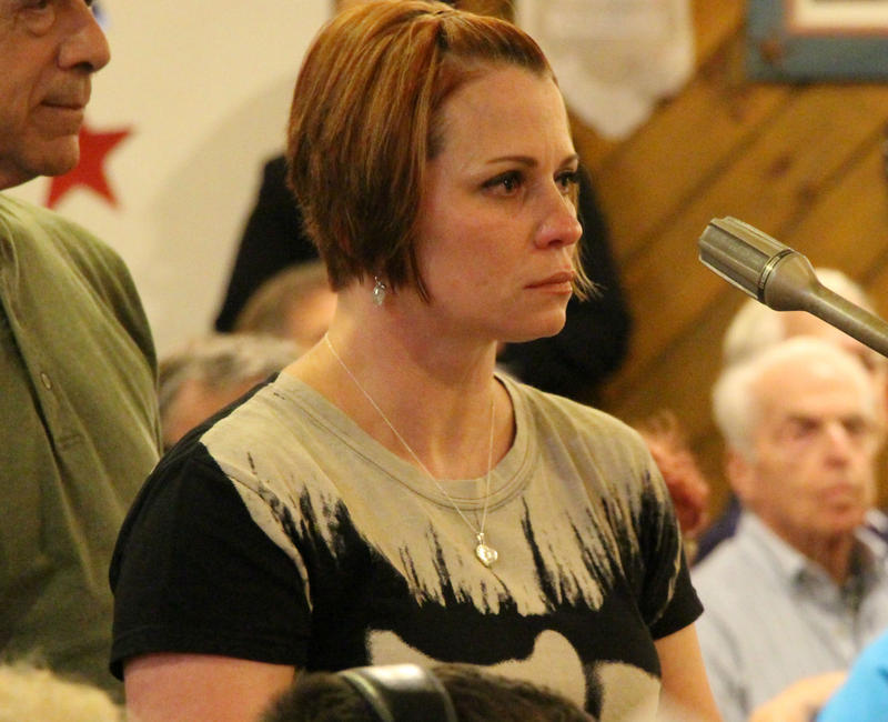 Veteran Cindy McGuirk speaks up for women veterans at a town hall meeting addressing concerns about the Manchester VA on July 31, 2017.