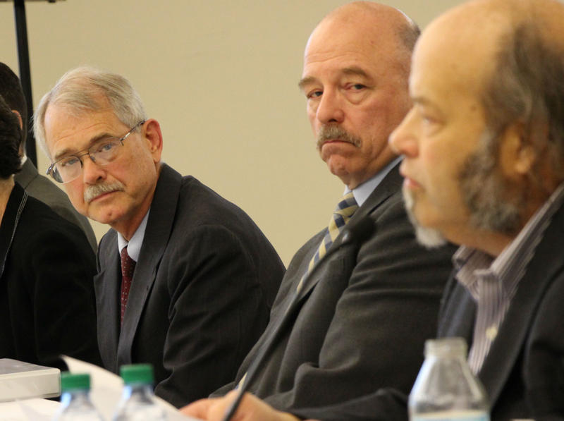 Dr. Michael Mayo-Smith (left) and Dave Kenney (center) listen as whistleblower Dr. Ed Kois (right) speaks at a congressional field hearing in Pembroke on Monday, September 18, 2017.