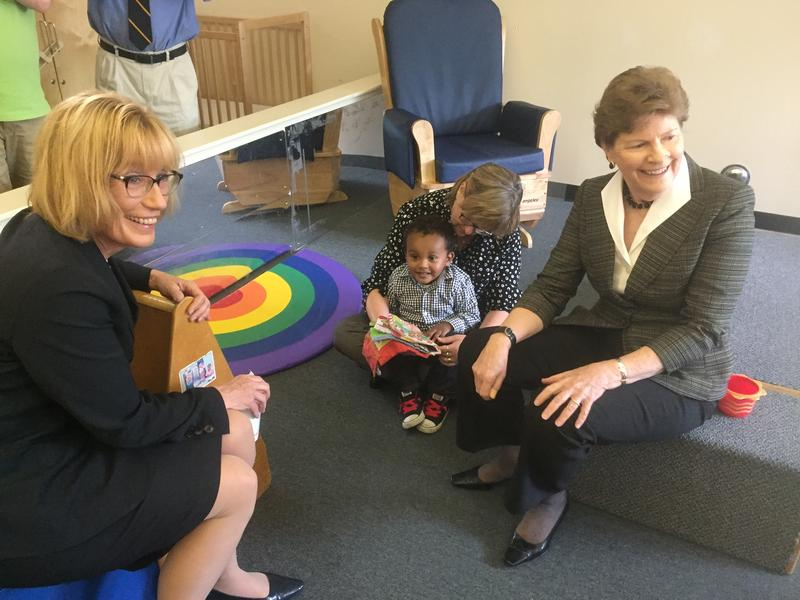Senators Maggie Hassan and Jeanne Shaheen play with one of the kids in Manchester's Head Start Program on Friday