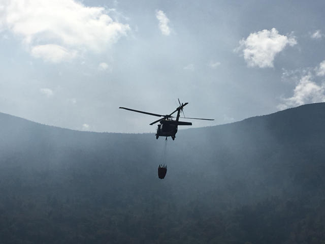 A helicopter en route to the forest fire.