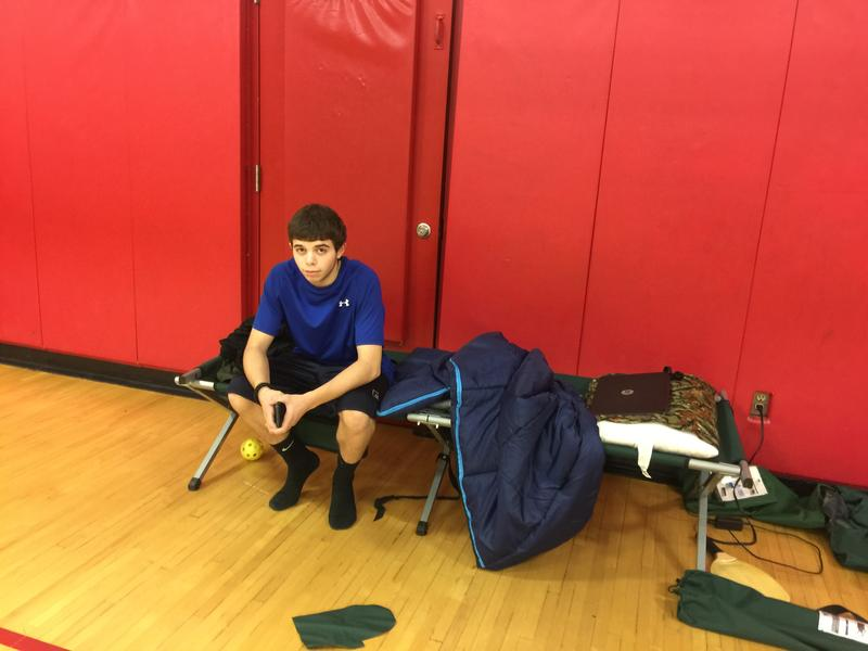 17-year-old Ethan Purcell on his cot at the Campton Elementary School.
