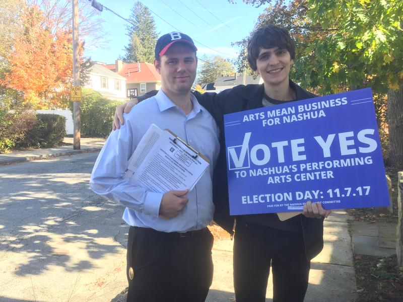 Nashua residents Michael Watt (left) and Connor Coburn (right) hit the streets to get support for a performing arts center downtown.