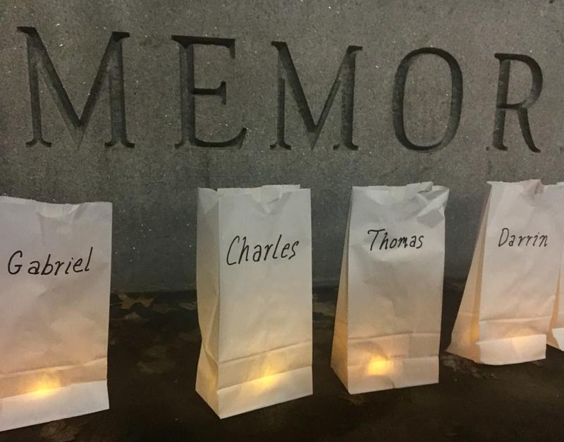 A group gathered in Manchester's Veterans Memorial Park honored the lives of more than 50 community members who died while experiencing homelessness in 2017.
