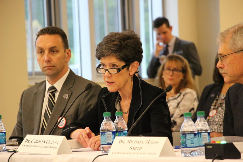 Dr. Carolyn Clancy (center) speaks at a congressional field hearing in September while Dr. Michael Mayo-Smith (right) and interim Manchester VA director Alfred Montoya (left) listen.