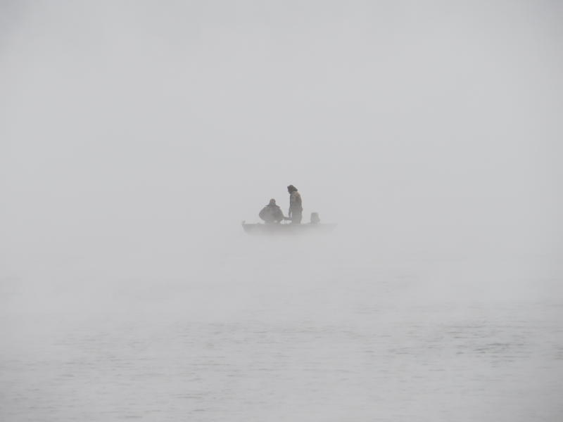 A boat appears out of the sea smoke Dec. 29, 2017, at the mouth of Rye Harbor.