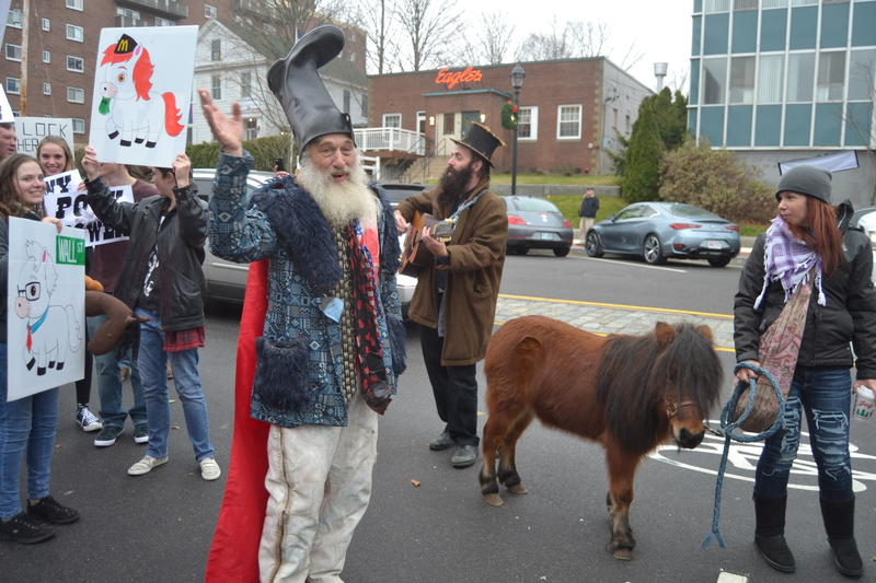 Vermin Supreme protests outside Hillary Clinton's book signing in downtown Concord.