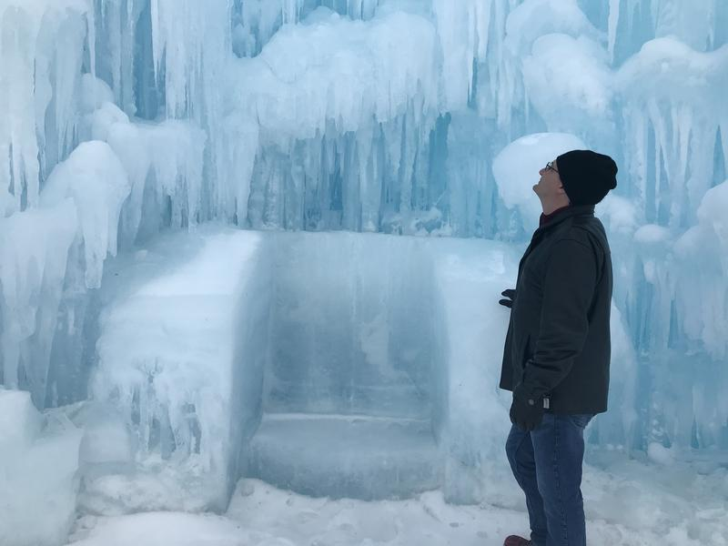 Morning Edition host Rick Ganley inspects the ice castle.