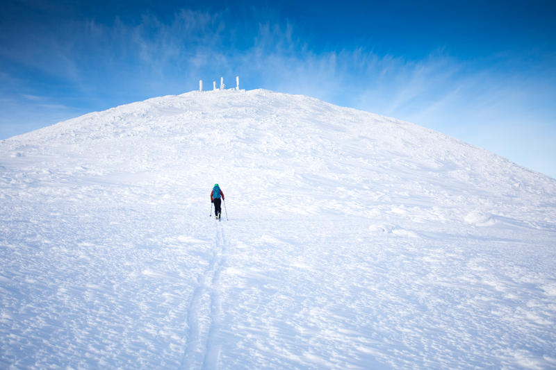 Andrew Drummond skinning up to the summit of Mt. Washington.
