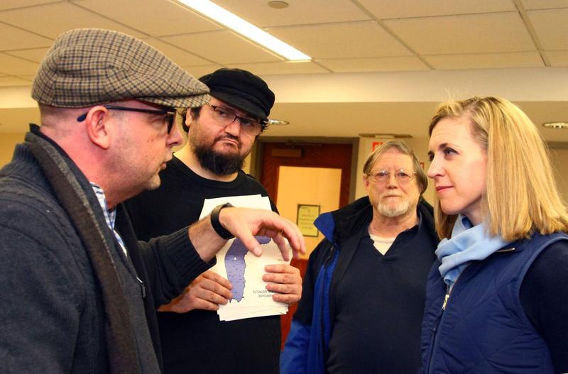 Maura Sullivan listens to a voter during a Londonderry Democrats' gathering Feb. 24. From left to right: Matthew Piette of Londonderry, Sean Cohen of Derry, and Lew Hadley of Plaistow.