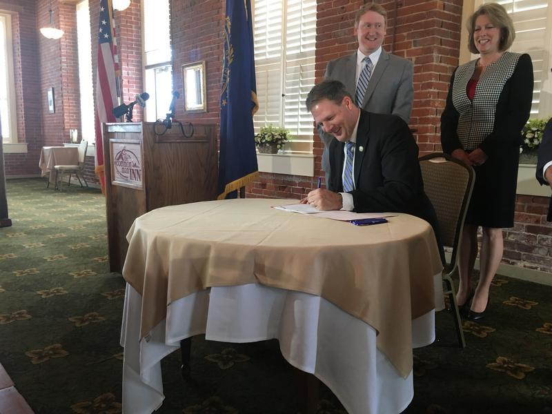 Governor Chris Sununu celebrated the work of local officials in pushing for tighter statewide lead regulations. Claremont Mayor Charlene Lovett (right) and Sen. Dan Feltes (D-Concord) stood with the governor at the signing Thursday in Claremont.