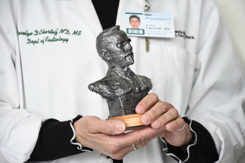 Jocelyn Chertoff, chair of the radiology department at Dartmouth-Hitchcock Medical Center, holds a 3-D printed sculpture created by scanning a century-old plaster mold from the collections of Saint-Gaudens National Historic Site in Cornish.