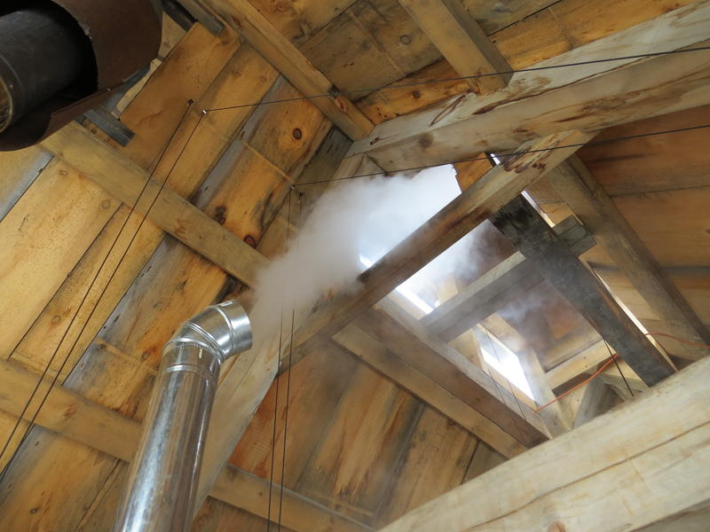 Steam fills the sugar shack as water evaporates from the sap while it cooks.