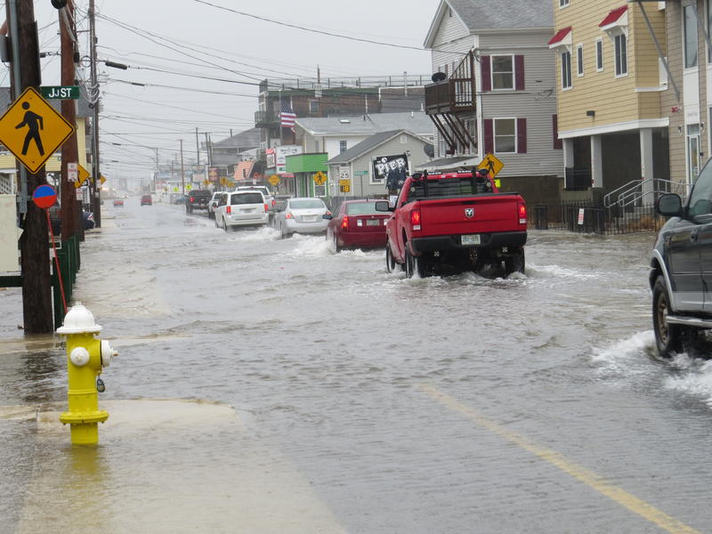 Motorists plow through rising flood water on Ashworth Ave/Route 1A in Hampton Beach