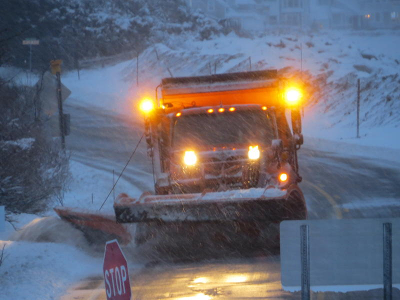 A NH DOT truck plows Route 1A on March 13, 2018.