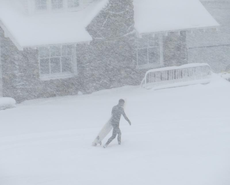 A surfer out for some waves in Rye Beach during the snow storm.