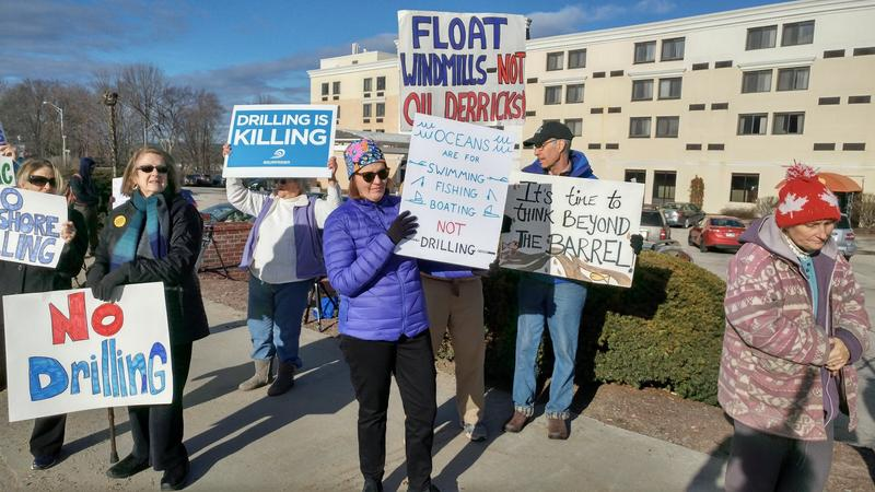 Protesters outside an offshore drilling information session in Concord Monday