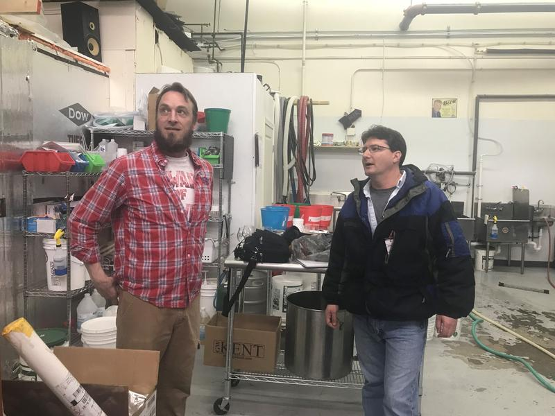 Co-owner of Lithermans Limited Brewery Michael Hauptley-Pierce, left, gives Morning Edition Host Rick Ganley, right, a tour of the brewing room.