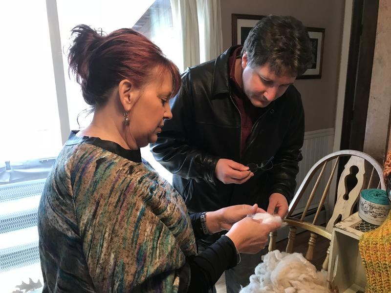 Dawn Tonkin shows Rick alpaca fiber she's collected from her herd.