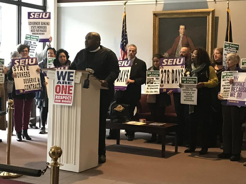 Rev. Eric Jackson of the Brookside Congregational Church in Manchester speaks during a rally for workers rights at the Legislative Office Building in Concord