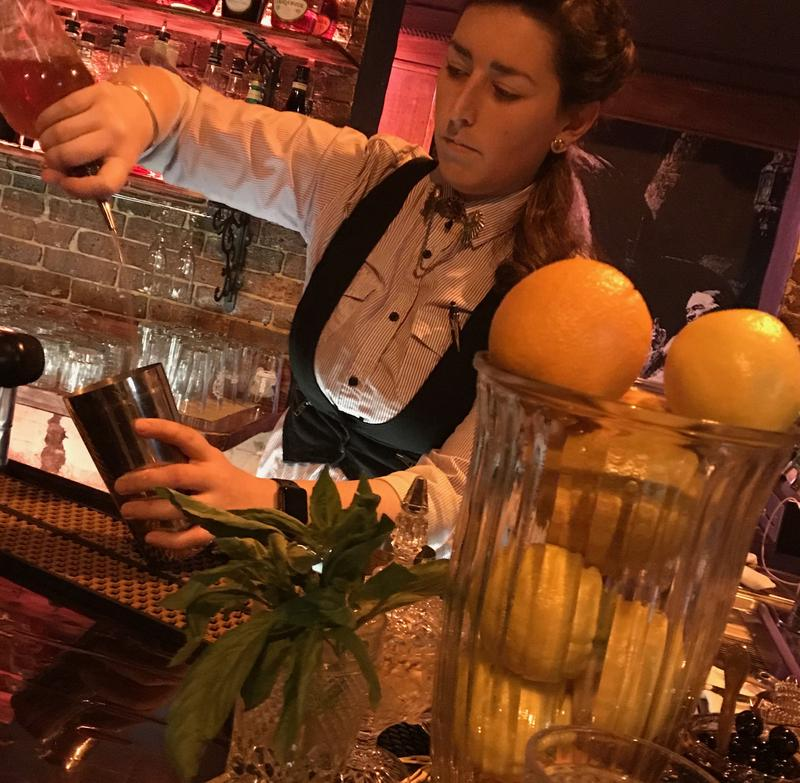 Kitty Martin prepares a cocktail at Chuck's Barbershop, a speakeasy-themed bar in Concord