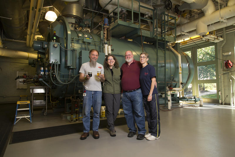 David Weeks, Cary Gaunt, Bill Rymes and Diana Duffy of Keene State College at the school's heat plant. Keene State is in the process of converting the facility to run off of 100 percent biofuels, rather than heating oil.