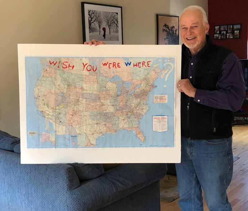 Bill Burtis, one of the co-chairs of the Portsmouth Poet Laureate Program board of trustees, stands with a map from former poet laureate Mark DeCarteret's outreach project.