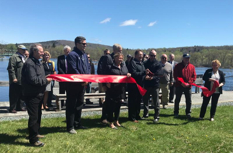 Berlin Mayor Paul Grenier cuts ceremonial ribbon for completed $7 million infrastructure project.