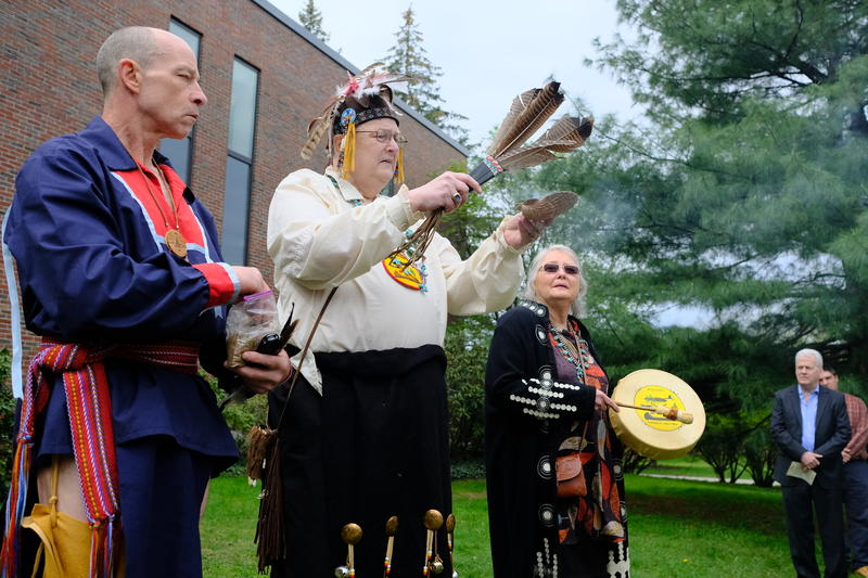 Chief Paul Bunnell leads a traditional smudging ceremony to bless the ground outside Keene State College's Mason Library, home to the school's Cohen Center for Holocaust and Genocide studies.