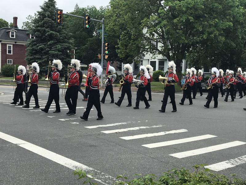 A marching band participates in Manchester's Memorial Day parade