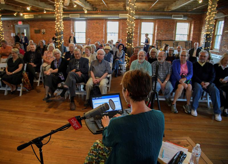 Host Laura Knoy introduces guests during the show at the Belknap Mill.